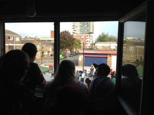 Campaigners look out onto the square from one of the reopened flats