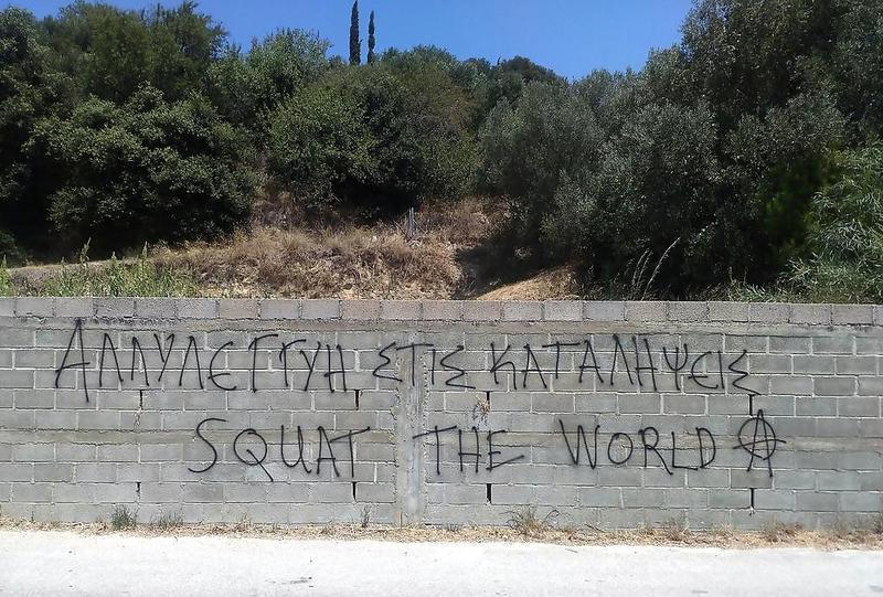 20160728_Solidarity_with_Squats_Squat_the_World_slogan_spray_painted_on_Cephalonia_Island_Greece